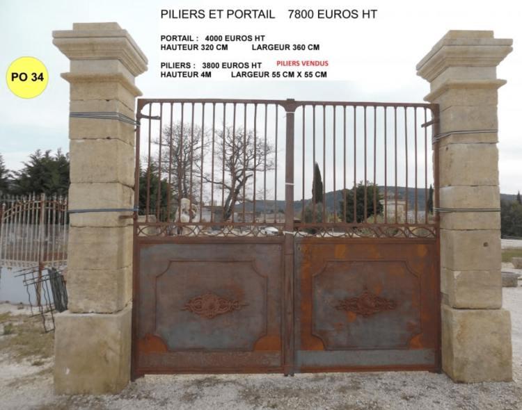 lemiere matériaux anciens 84 vend un portail ancien en fer forge avec grille en fer forgé exposé à Valaurie